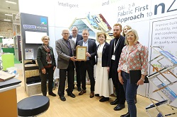 Niall Crosson receiving award for Celenit at ArchiExpo 2019
