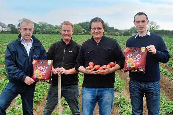 Potato growers pose with the end product.
