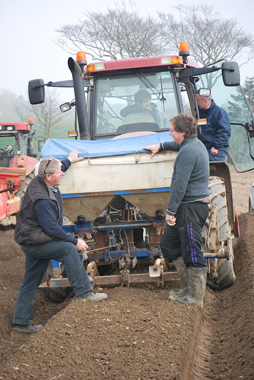 Owen Kirwan chats to our Farm Manager Conor as his son Aidan stops sowing to talk to Robert, our General Manager.