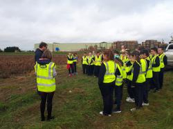 Students of Heronstown and Newtown NS in Lobinstown listen to the fundamentals of potato growing as explained by Meade Potato Company Farm Manager Conor O'Malley in advance of National Potato Day.