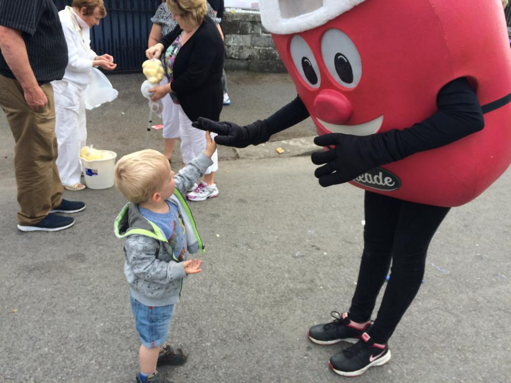 Mr. Rooster meets a young fan at the Clonmellon Potato Festival held on 16 August in Clonmellon, Westmeath