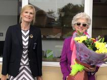 Captain Barbara presenting flowers to Ann Lynch in appreciation for her support to the Women's Club.