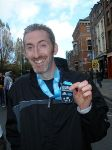 Andrew with his medal