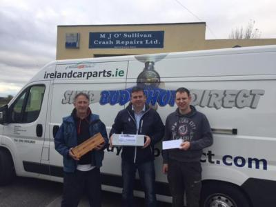 Our Rep Senan presenting Oliver Fitzgerald and David O'Callaghan with their Raffle prizes